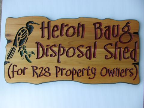 Engraved wood sign heron