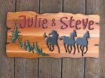 Ranch style wooden sign with horses