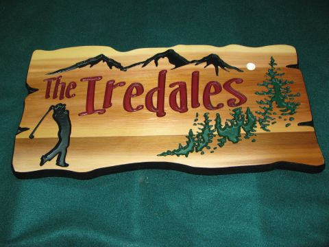 Wood sign with golfer mountains and trees