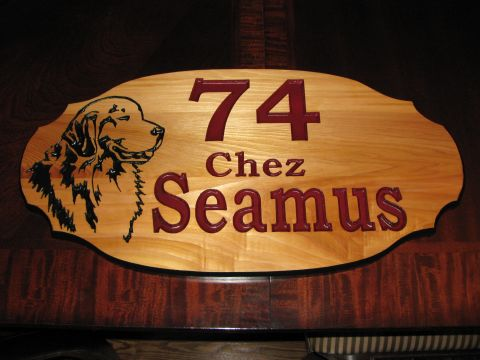 Dog and house address engraved in wood