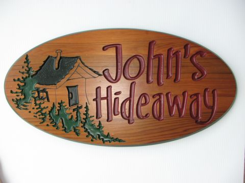 Engraved sign Johns Hideway
