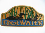Wooden engraved cottage sign edgewater loons reeds water