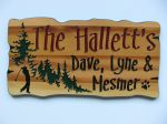 Rustic wood sign trees golfer family name and members name with dog paw print