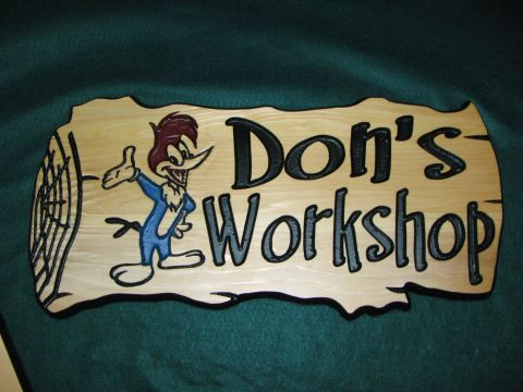 Wood engraving of a a sign for don's workshop